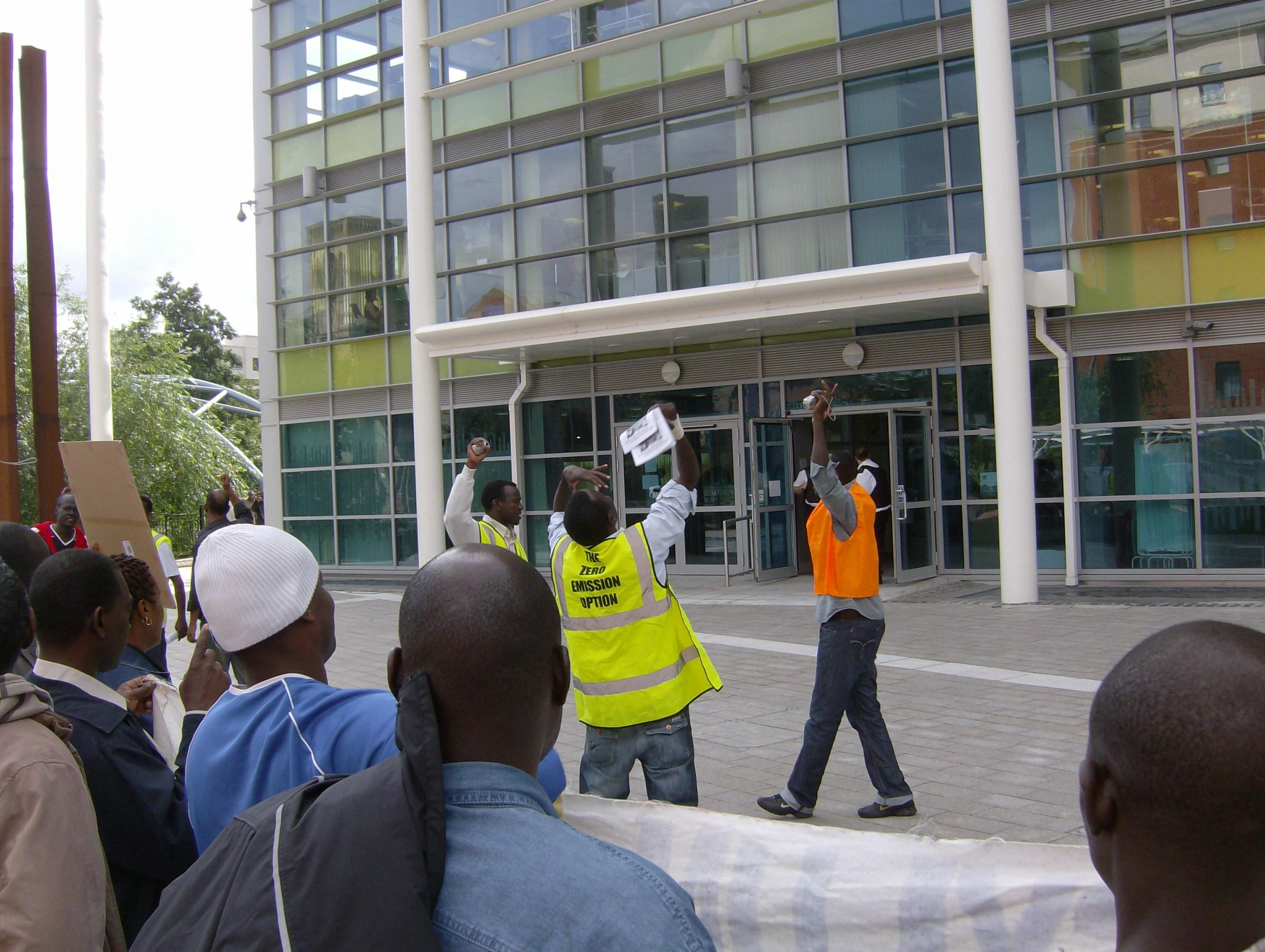 August 2008: South Yorkshire Sudanese community demonstrating outside Vulcan Hose for the right to work and to be treated respectfully. We soon discovered the newly built glass and steel Home Office HQ and surroundings had excellent acoustics.