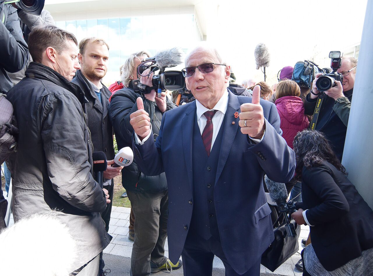 Trevor Hicks giving the thumbs up to the press after the inquest verdict