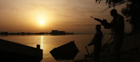 British Army soldiers on the banks of the Shatt Al Arab waterway in Basra, Iraq. Press Association/Lewis Whyld. All rights reserved