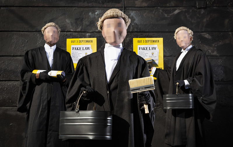 Secret Barrister plus two masked associates on the promotional campaign