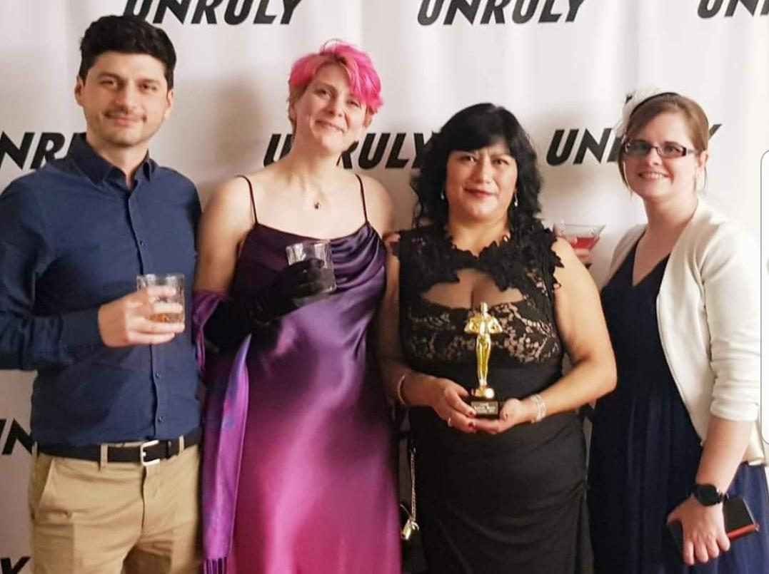Marisol - with trophy - and her Unruly colleagues